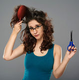 Woman doing haircut with scissors Royalty Free Stock Photos