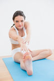 Woman doing the hamstring stretch on exercise mat Royalty Free Stock Image