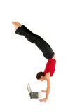 Woman doing handstand. And using laptop Stock Image