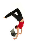 Woman doing handstand. And using laptop Royalty Free Stock Photography