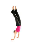 Woman doing handstand. Young woman doing handstand over white background Royalty Free Stock Photo