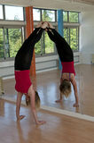 Woman doing a handstand Stock Images