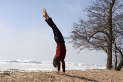 Woman doing handstand on beach Royalty Free Stock Images
