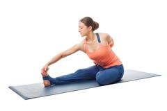 Woman doing Hatha yoga asana Ardha baddha padma paschimottanasan Royalty Free Stock Images