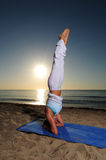 Woman doing headstand yoga pose Royalty Free Stock Photography