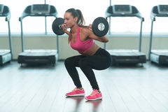 Woman Doing Heavy Weight Exercise With Barbell Royalty Free Stock Image
