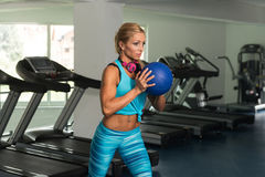 Woman Doing Heavy Weight Exercise With Medicine Ball Stock Images