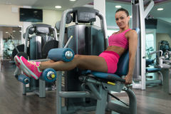 Woman Doing Heavy Weight Exercise For Quadriceps Royalty Free Stock Image