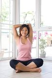 Woman doing her arm stretching exercise Royalty Free Stock Photos