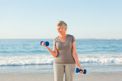 Woman doing her exercises at the beach Stock Photography