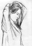 Woman doing her hair, pencil sketch. Hand drawn pencil sketch of a young woman doing her hair Stock Images
