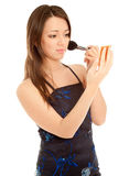 Woman doing her make up Stock Photo