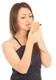 Woman doing her make up Royalty Free Stock Image