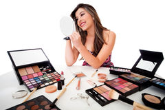 Woman doing her makeup Royalty Free Stock Images
