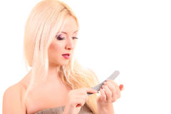 woman   doing her nails Royalty Free Stock Images