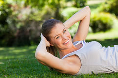 Woman doing her stretches in the park Royalty Free Stock Image