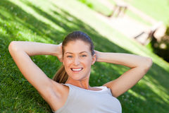 Woman doing her stretches in the park Stock Photos