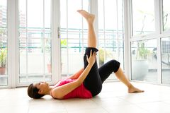 Woman doing her stretching exercise Royalty Free Stock Images