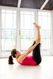 Woman doing her stretching exercise Stock Photo