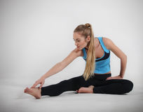 Woman doing her yoga stretch Royalty Free Stock Photo