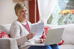 Woman doing home banking Royalty Free Stock Photography