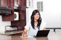 Woman doing home finance Stock Photography