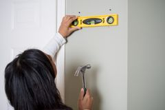 Woman Doing Home Repairs Royalty Free Stock Photos