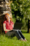 A woman doing homework in the park Royalty Free Stock Photos