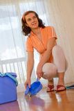 Woman doing house work - housekeeping Royalty Free Stock Photos