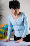 Woman doing household chores Stock Photography