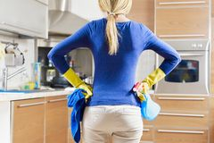Woman doing housekeeping royalty free stock photos