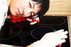 Woman doing housekeeping Stock Photography