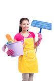 Woman doing housekeeping stuff at home isolated on white backgro Stock Photography