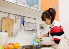 Woman doing housework Stock Images