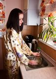 Woman doing housework Royalty Free Stock Photography