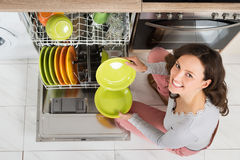 Woman Doing Housework. High Angle View Of Young Woman Doing Housework In Kitchen Stock Image