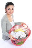 Pretty asian woman with laundry Royalty Free Stock Photos
