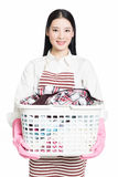 Woman doing a housework holding basket of laundry Royalty Free Stock Image
