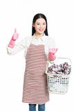 Woman doing a housework holding basket of laundry Royalty Free Stock Photography