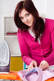 Woman doing housework. Portrait of a young beautiful woman doing housework stock image