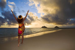 Woman doing hula at sunrise at lanikai Stock Photo