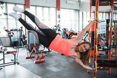 Woman doing human flag exercise Stock Photo