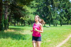Woman doing jogging outdoors Stock Images
