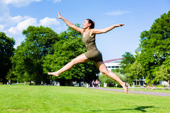Woman doing jump Stock Photo