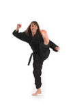 Woman doing karate Stock Photos
