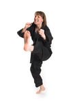 Woman doing karate Stock Images