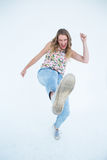 Woman doing karate kick Stock Photography