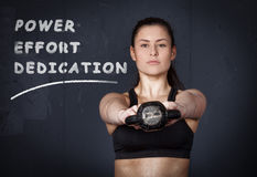 Woman doing a kettlebell fitness exercise Stock Images