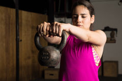 Woman doing kettlebell swings Royalty Free Stock Image