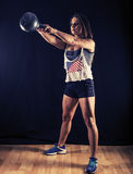Woman doing kettlebell swings Royalty Free Stock Photography